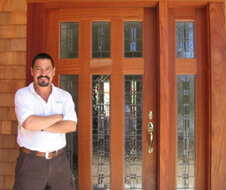 Genaro with a newly installed entryway window
